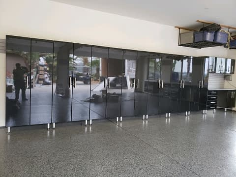 Black Tall Modular Garage Cabinets with workbench and Epoxy Floor